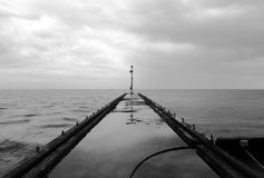 Small Pier. And cloudy sky Royalty Free Stock Image