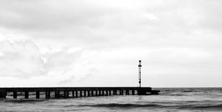 Small Pier. And cloudy sky Stock Photo