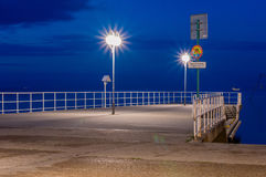 Small pier in Gdynia at Feliks Nowowiejski boulevard on Baltic sea at night. Stock Photography