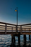 Small pier II. Detail of a sunrise from a small pier Royalty Free Stock Photos