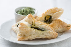 Small pies stuffed with spinach Stock Photo