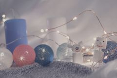 small pig and snowman from marshmallows against the background of Christmas decoration royalty free stock images