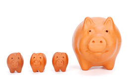 Small piggy banks near big one Royalty Free Stock Photography