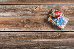 Small pile of books and apple on school desk Royalty Free Stock Photo