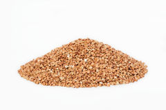Small pile of buckwheat. Isolated on white background Stock Photography