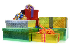 Small pile of Christmas gift boxes or presents isolated on white background Stock Photo