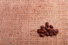 Small pile of coffee beans of burlap Stock Photography