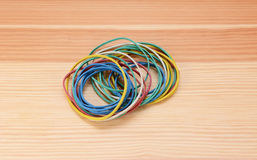 Small pile of coloured elastic bands Stock Image
