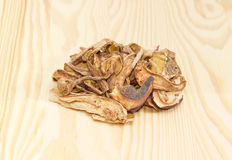 Small pile of dried boletus on a wooden surface Royalty Free Stock Photos
