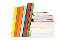 Small pile and leaning row of colorful books  on white Stock Photography