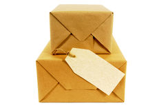 Small pile of mail packages, blank manila address label, isolated Stock Photo