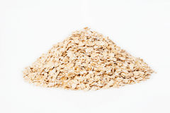 Small pile of oat. Isolated on white background Stock Photography