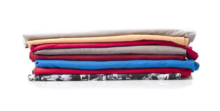 Small pile of t-shirts. On white background stock photo