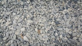 Small piles of limestone for use in lime kiln line . Limestone gravel background Texture royalty free stock photos
