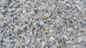 Small piles of limestone for use in lime kiln line . Limestone gravel background Texture royalty free stock photo