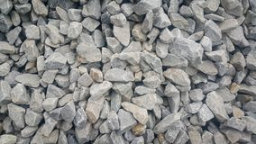 Small piles of limestone for use in lime kiln line . Limestone gravel background Texture royalty free stock images