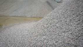 Small piles of limestone for use in lime kiln line . Limestone gravel background Texture stock photography