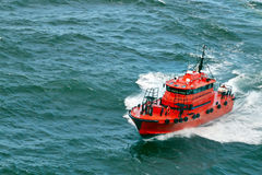 Small pilot boat  sailing in the ocen Royalty Free Stock Images