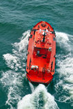 Small pilot boat  sailing with waves Royalty Free Stock Photo