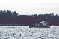 Small pilot ship Stock Image