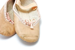 Small pink ballet shoes Stock Photos