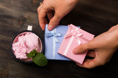 Small Pink and Blue Gifts and Ice Cream Royalty Free Stock Images