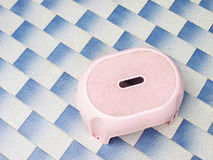 Small pink chair. On tile floor Royalty Free Stock Photography