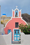 Small pink chapel on santorini island, greece Stock Photo