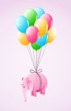 Small pink elephant flying at colourful air Royalty Free Stock Photography