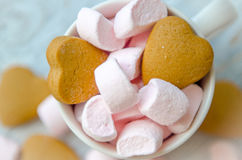 Small pink marshmallow with biscuits in the cup stock photography