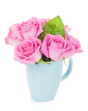 Small pink rose flowers bouquet in tea cup Stock Photography