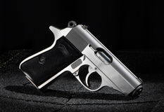 Small Pistol on Black Background Stock Photo