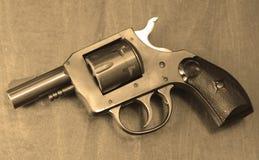 Small pistol in sepia Stock Photos