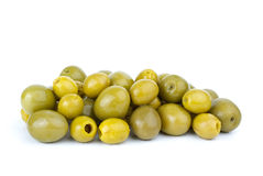 Small pitted and giant olives. Isolated on the white background stock photo