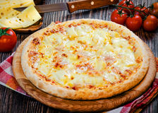 Small pizza margaritta. On the table Stock Image