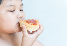 Small pizza in obese fat boy hand. Stock Images