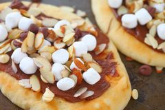Chocolate pizzas on naan bread Royalty Free Stock Photos