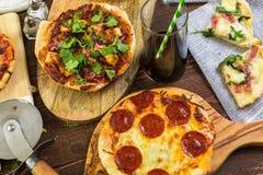 Small pizzas Stock Photos