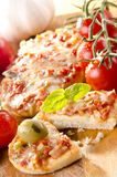 Small pizzas with peppers Stock Image