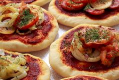 Small pizzas (pizzette) royalty free stock images