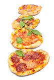 Small pizzas in a row Royalty Free Stock Photography