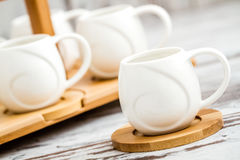 Small Plain Porcelain Coffee Cups on Bamboo Tray Stock Photos