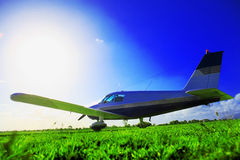 Small plane. Waiting on grassy field Royalty Free Stock Image