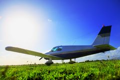 Small plane. Sitting in field ready to take off into clear skies stock photo