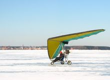 Small plane. Man flies up by small plane. Winter stock images