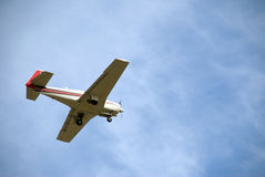 Small Plane. With wheels out coming in for a landing. Nice blue sky Stock Image
