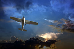 Small plane against a stormy sky Royalty Free Stock Photos
