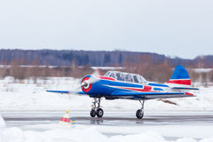 Small plane at the airport in winter Royalty Free Stock Photography
