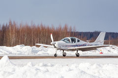 Small plane at the airport in winter Stock Photography