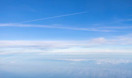 Small plane in the boundless sky above clouds Royalty Free Stock Images